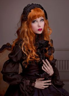 Neo-Victorian Goth girl with lovely red hair