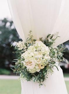 Photography: Virgil Bunao Photography - http://www.stylemepretty.com/portfolio/virgil-bunao Floral Design: Sara York Grimshaw Designs - http://www.stylemepretty.com/portfolio/sara-york-grimshaw-designs Wedding Dress: Inbal Dror - http://www.stylemepretty.com/portfolio/inbal-dror-3   Read More on SMP: http://www.stylemepretty.com/2015/02/16/traditional-charleston-plantation-wedding/