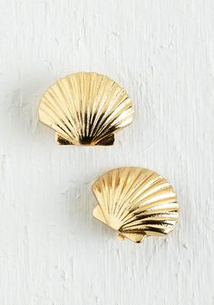 Sea Things Through Earrings. From your morning routine til its time for lights out, these golden seashell earrings have you totally covered in the cute style department. #gold #modcloth
