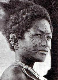 Hula Facial tattooing, ca. 1915. The two fringed parallel lines extending from the corners of the mouth towards the ears are a centipede motif. Among the Motu, this pattern is usually tattooed on the cheeks of a chief's child. The stepped designs (lakatoi) that appear on the girl's face proclaim that her father participated in several successful trading voyages.