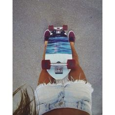 I love how her board is a scene of the beach <3