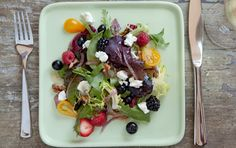 Use seasonal berries for this refreshing salad, matching tangy goat cheese with sweet berries, roasted red onions, walnuts and tomatoes.