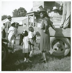 African American Family, c. 1940 An African American woman buying ice-cream for children from a truck, Natchitoches, Louisiana. Source: Farm Security Administration Collection. The New York Public Library. Schomburg Center for Research in Black Culture by Black History Album