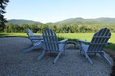 Adirondack chairs around a firepit