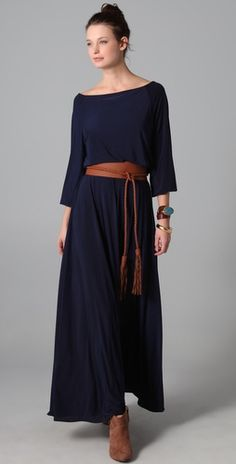 "Odylyne  Sterling Long Dress  297.00  Style # ODYLN20016  This wide-neck jersey maxi dress features a double-layered blouson bodice and a detachable, fringed faux-leather belt. Gathered elastic banding at waist and cuffs. Long raglan sleeves.    * 58"" long, measured from shoulder.  * Fabrication: Slinky jersey.  * 95% polyester/5% spandex.  * Dry clean.  * Made in the USA  Stephanie Lampkin founded Odylyne in 2009"