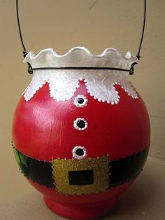 Santa candle holder. I would try the krylon glass spray paint I picked up at mike's.   It says it's translucent. Cute idea.