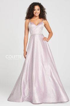Colette for Mon Cheri CL12004. Sleeveless novelty glitter ball gown with a v-neck, beaded detail at the natural waist, strappy back, full skirt with a horsehair trim. Features Pockets