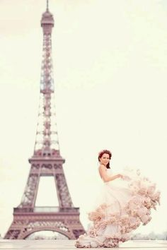Paris wedding blush pink gown with curly swirly ruffled underskirt