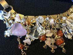 Treasure Bracelet Artist: Teresa Bradford Heavy brass chain and clasp 6 3/4 inch length with clasp Amethyst, Amber, Quartz Crystal, Rose Quartz with a sprinkling of Tribal. $340-  Such a wonderful Treasure Here at My Etsy Site I Represent Myself and also Artists of the California Coast. Find your spirit and your style! I have a wonderful collection of goodies quality, hip, classic, traditional Yes ~ along with basic simplicity ~ Its all about you ~ You deserve to know about my fabulous T...
