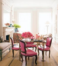 Love this small gathering space with the beautiful pink chairs and flowers!