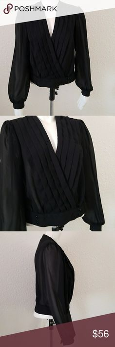 """Vintage Retro Ms. Paquette Black Pleated Wrap Top Now this little mama is fabulous! Vintage Polyester top blouse from Ms. Paquette of California in a size small. Despite its vintage production, so now right? Pleated front that has four buttons at hem for closure. Top is open. Sleeves are puffy, boloero style. One button at each wrist. Light shoulder pads inside. Chest approx. 19"""" acropss front under arms. Shorter length of 20"""". Sleeves 23"""". Made is USA. True Vintage Tops Blouses"""