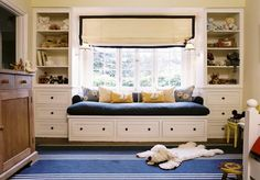 DIY window seat and bookshelves would bring the bookshelves to the forefront and use a different finish but this is close