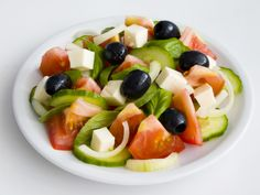 Classic Greek Salad. Got lots of leftover tomatoes from your garden? This super-easy fresh tomato and feta cheese salad with olives is Greek to me! Give it a try.#MediterraneanDiet