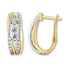 Two-tone gold and diamonds add an element of intrigue to these distinctive hoop earrings.