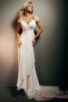 T212267 Chiffon over satin soft A-line gown with hand-beaded illusion and lace cap sleeves, sweetheart neckline, crisscross ruched bodice, low scoop illusion and lace back bodice trimmed with draping, cascading side draped skirt with chapel length train.