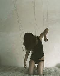 Puppet on a string. Break free.