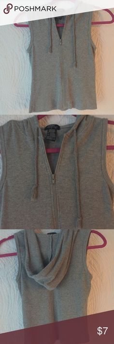 One Step Up Sleeveless Hoodie One Step Up Women's Sleeveless Hoodie.  Size Medium, Gray thermal material, zip up front.  18 inches from shoulder to bottom hem.  Good Condition. One Step Up Tops Sweatshirts & Hoodies
