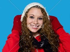 portrait of a smiling young woman in winter clothing. - Portrait of a smiling young woman in winter clothing over turquoise background, Model: Brittany Beaudoin