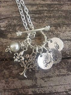 Hey, I found this really awesome Etsy listing at https://www.etsy.com/listing/196603505/family-initial-charm-necklace-with