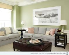 Warm sage green living room with rusty orange. See website for ...