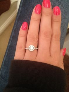 Halo Engagement Ring. 18k white gold, 9 diamonds down each shoulder, with 14 around one brilliant cut middle diamond.