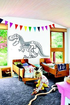 Dinosaur wall - shared boys room.  I have the garland cut out just need time to sew!