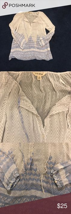 Lucky Brand Sheer Rayon Top Sheer light lavender and white zig zag pattern, with a blue, white and lavender floral/geometric pattern at the bottom of the top and sleeves. Lightly used. Looks super cute tucked into high-waisted jeans. Lucky Brand Tops Blouses