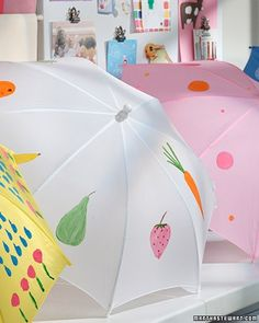 It's fun and easy to decorate a nylon umbrella with acrylic paint and a brush. This is a perfect project for kids because they can choose and apply the design all on their own -- or with a little guidance from a parent. Be sure, however, that the paint is acrylic as other paints don't have the same waterproof qualities. To make a painted umbrella, cover a work surface with newspaper, open up a child-size umbrella, and start painting. Keep the umbrella stay open overnight to allow the paint…
