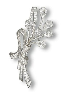 A DIAMOND CLIP BROOCH, BY VAN CLEEF & ARPELS  Designed as a floral spray set with six pear-shaped diamonds weighing 2.96, 2.67, 2.17, 1.87, 1.65 and 1.54 carats, to the baguette-cut diamond stems and brilliant-cut diamond ribbon, mounted in platinum and 18k white gold, 8.0 cm long, with French assay marks for platinum and gold