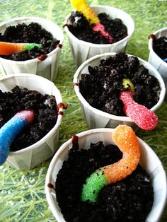 Gummy Worm Dirt Cups  sometimes known as: dirt cake    chocolate pudding  oreo cookies, crushed  gummi worms (we hold a special place in our hearts for the sour ones)    Fill each cup with desired amount of pudding, top with a worm or two, sprinkle some crumbled cookies on top and shock your guests with the deliciousness of an earth friendly dessert! applejaxx99