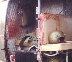 The blood covered inside of a Huey helicopter after a mission. ~ Vietnam War