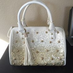 Beautiful, once used, purse White, gold sparkles, very spacious. very clean, only been used one time ! bought from charming charlies Charming Charlie Bags