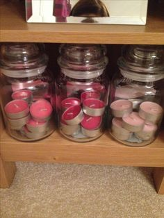 Using Yankee candle jars as tea light storage!