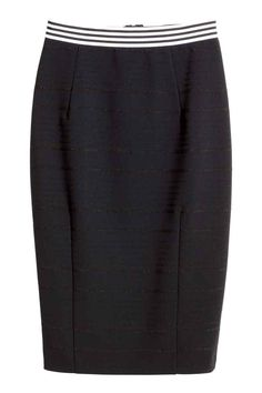 Pencil skirt: Knee-length pencil skirt in sturdy fabric with a visible zip and slit at the back. Unlined.