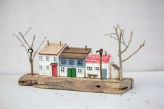 "One of a kind. three white house miniatures with tin roofs and nails as chimneys. two long nails as street light. little wood bench. Completly hand made from recycled driftwood and other metal work details. + Hand painted with acrylics + Recycled drift wood, nails + Measurments: 12.5x7x4"" / 32x17.5x10.5 cm approx. + Free shipping worldwide"