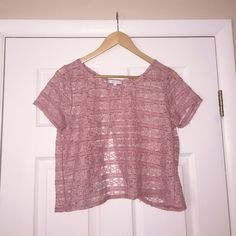 Light Pink Lace Top with Open Back This top is in EUC! Worn a few times before. Top is light pink, lace material, and has an open back. Size is large. Works great with a bandeau or bralette underneath, or as a coverup! Perfect for warmer weather. Tops