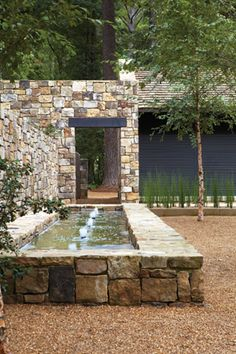 Located in the United States, this beautiful stone residence was designed by Paul Bates Architects. Photography courtesy of Paul Bates Architects Outdoor Water Features, Pool Water Features, Water Features In The Garden, Modern Fence Design, Garden Fountains, Outdoor Fountains, Garden Ponds, Koi Ponds, Water Fountains