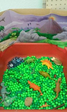 dinosaur sensory bin small world play. we even used a recycled juice mix container to add a volcano with orange & red sensory sticks!