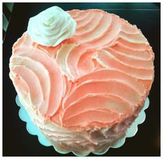 Coral Textured bridal shower cake with fondant flower. simple and way cute.