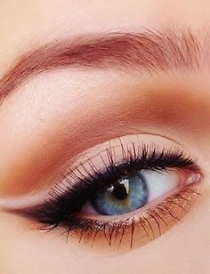 Add depth to your makeup look by pairing your cat-eye with a neutral shade in the crease and a white shadow highlight on the wing.