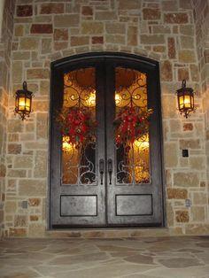 front door - love the iron work,  and that it is a double door.