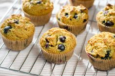 Blueberry Paleo Muffins | These gluten-free blueberry paleo muffins are one of my favorite breakfasts. They fill the kitchen with the smell of blueberries, almonds, lemon and honey. There's nothing better than a warm homemade blueberry muffin and a cappuccino on a sunny morning. @Kristin Plucker Yager Cook Eat Paleo
