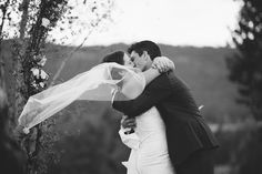 epic first kiss! Love the veil flying in the wind.