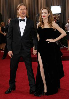 Actress Angelina Jolie, right, and actor Brad Pitt arrive before the 84th Academy Awards on Sunday, Feb. 26, 2012, in the Hollywood section of Los Angeles. Jolie wore a black velvet Atelier Versace gown to the event.