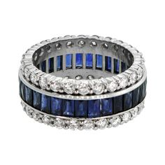 Beautiful Vintage Sapphire and Diamond Wedding Band set with a row of channel set French cut sapphires with a band of shared prong set diamonds on each side.
