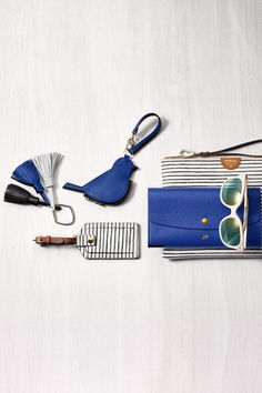 Our collection of wallets, luggage tags, bag charms and sunglasses are pretty in blue and make fabulous grad gifts.