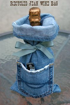 Denim wine bag.  Awesome idea.   The only sewing necessary is a single stitched seam across the bottom | http://betweennapsontheporch.net