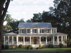 Farmhouse with wrap around porch & metal roof