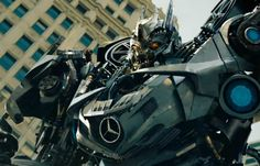 """Perhaps the most expensive Mercedes on the big screen was the 2011 SLS AMG in Transformers – Dark of the Moon, when the SLS transformed into Soundwave the Decepticon. You can see from this image that they even retained the OEM Wheels in the film. Above the shoulders are the Factory Original 20""""x11"""" 7 Spoke wheels (interchange number 85193).   www.usedmercedesrims.com  #oemwheels #stockwheels #originalwheels #mercedes #amg #sls"""