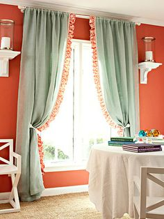 Great ideas:  The big candle sconces  on either side of the window; the curtains hung just beneath the ceiling.